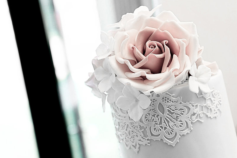 Intricate details of an edible flower created for a wedding cake