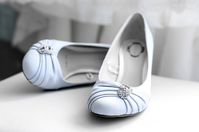 Stunning pale blue wedding shoes displayed on the morning of a bride's wedding day