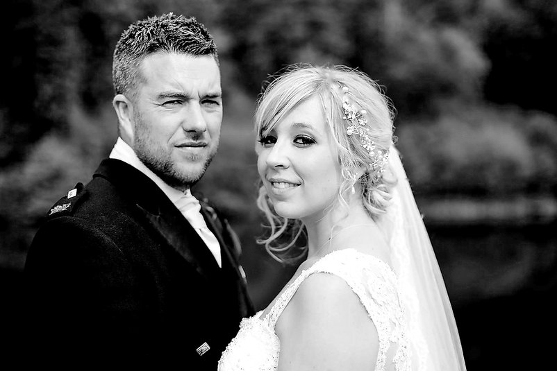 A bride and groom on their wedding day at Canada Lodge and Lake near Cardiff, South Wales