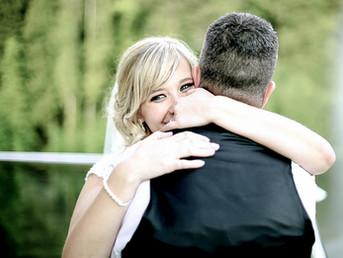bride-hugging-groom-canada-lake-lodge-south-wales.jpg