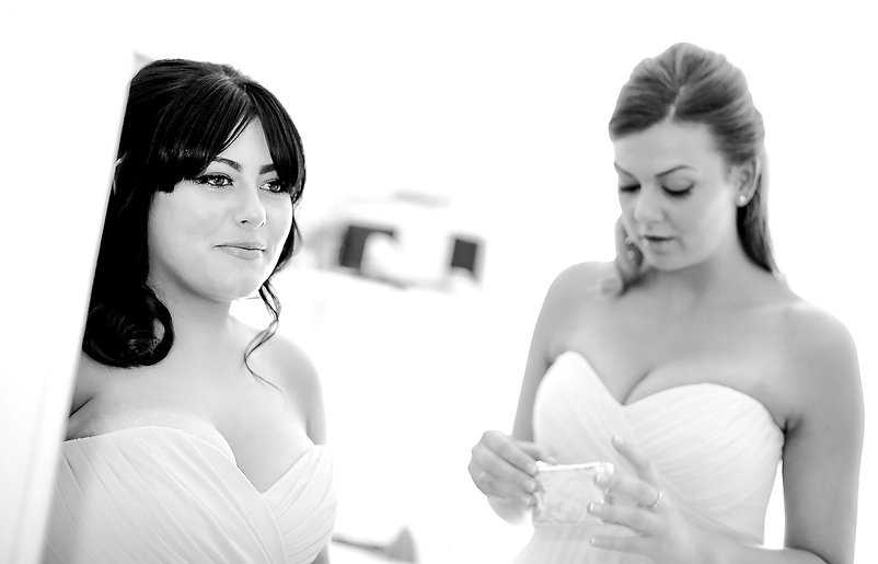 Two bridesmaids looking calm but also a little anxious on the morning of the wedding