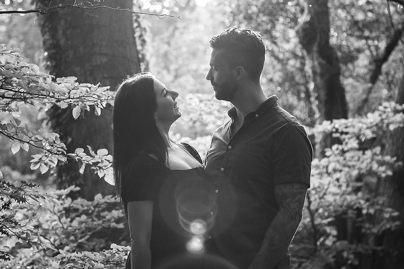 A young couple lovingly glare at each other in Hensol Forest, South Wales