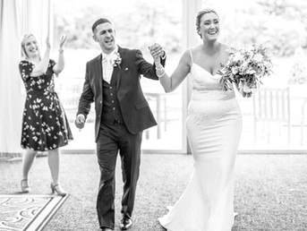 bride-and-groom-leaving-ceremony-venue-happy-as-newly-wed-husband-and-wife.jpg