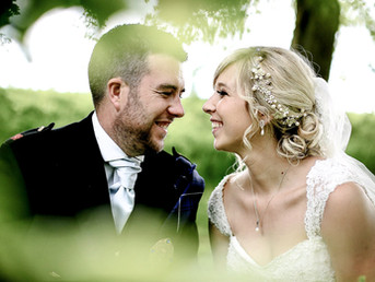 bride-and-groom-smiling-at-each-other-canada-lake-lodge-south-wales.jpg