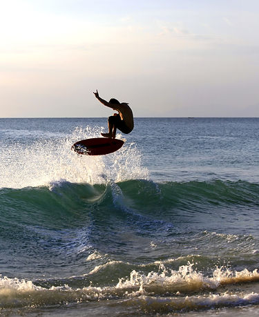 A student catched a wave on a skimboard..