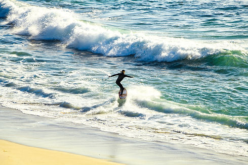 A man surfing on a wave.
