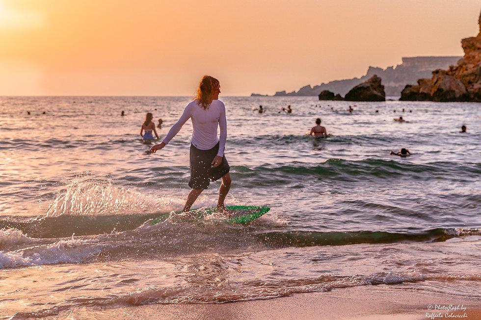 Skimboarding at the beach of Għajn Tuffieħa in Malta.