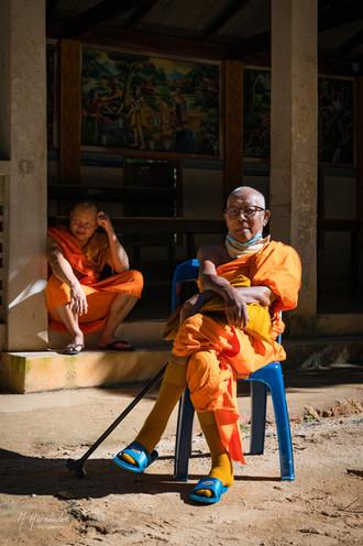 Senior monk taking an early morning sun bath at Mae Kampong, Thailand. 2017