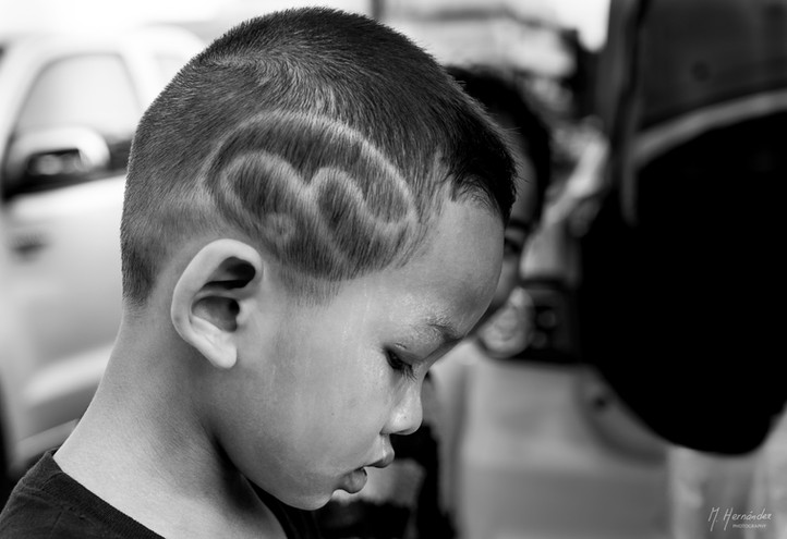 Little one honoring the late King Rama IX with his haircut at Bangkok, Thailand. 2016