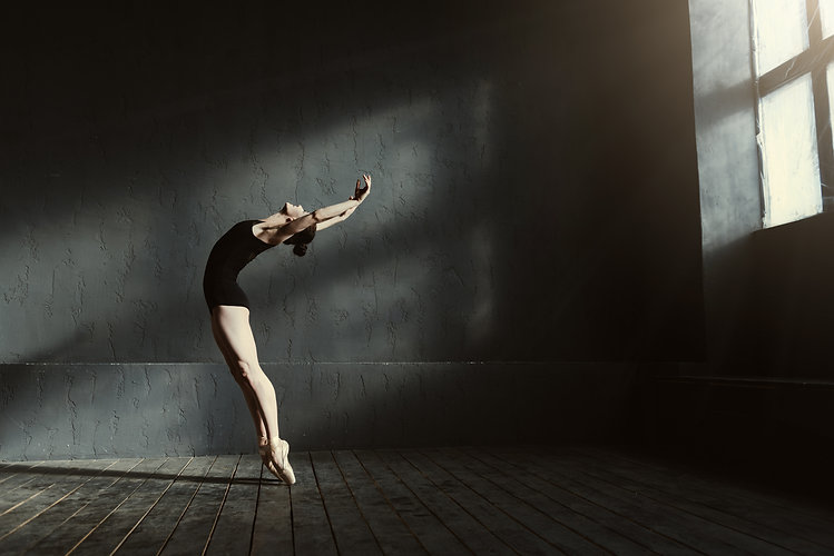 Flexible ballet dancer stretching in the