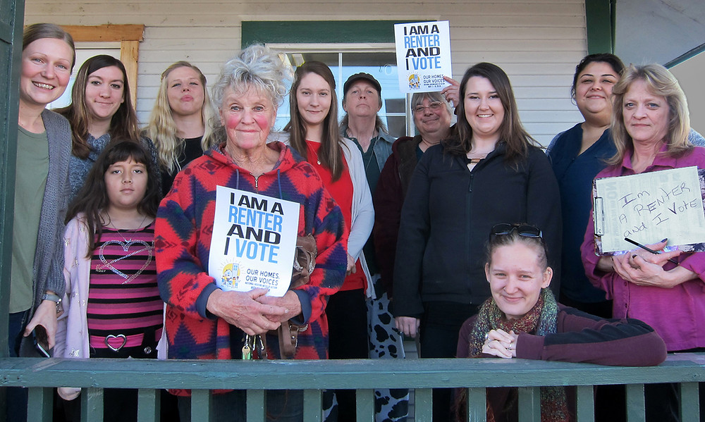 "Photo of Southern Oregon renters holding signs that say ""I rent and I vote."""