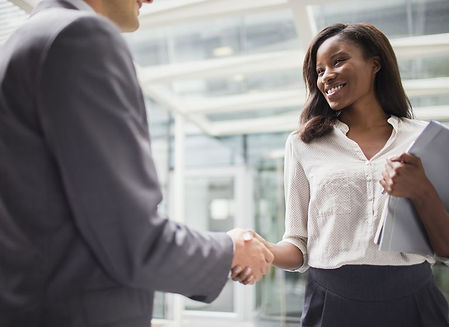 business-people-shaking-hands-outside-of