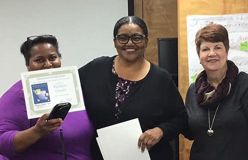 3 women holding an award