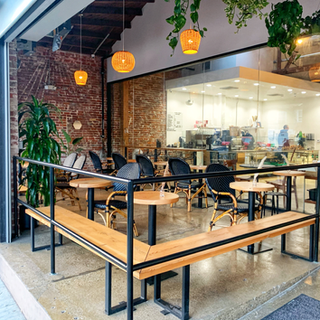 l bench and round tables for clark street bakery