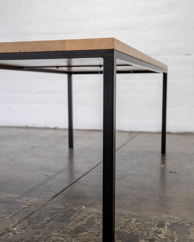 light wood on matte black steel frame