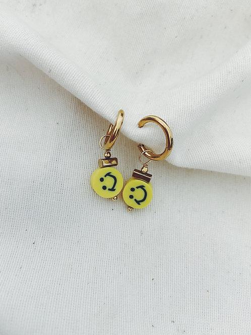Cara feliz amarilla