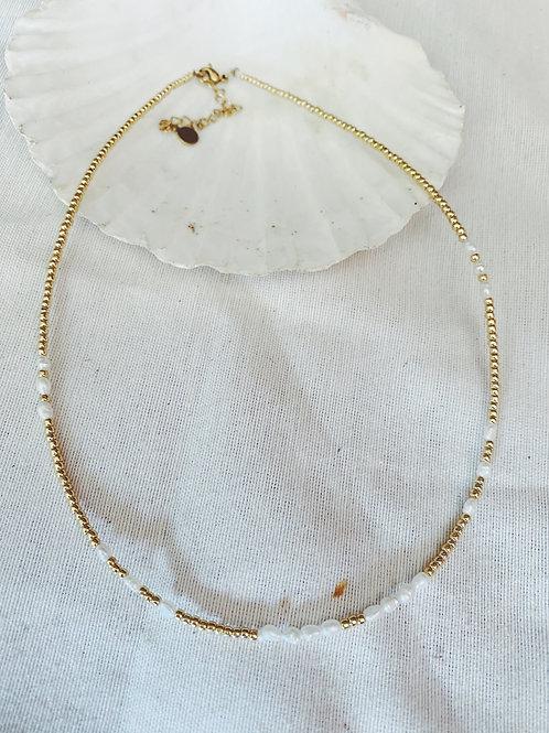 Perlas y bolitas doradas