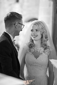 Bride and Groom look at each other during their wedding at St Michael's Church, Droitwich.