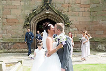 Bride and goom celebrate after their wedding in Kings Norton, Birmingham.