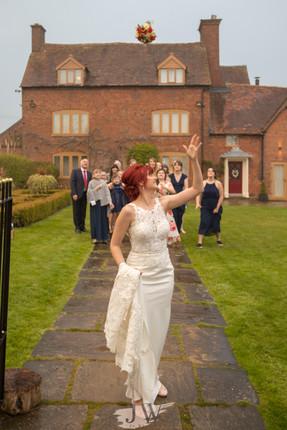Bride tosses her flowers