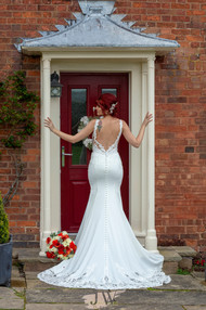 Bride in doorway with flowers