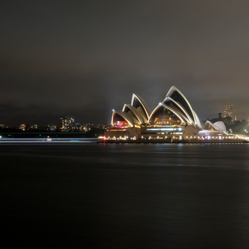 Sydney Opera House with light trails from passing boat.
