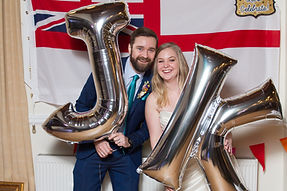 Bride and groom celebrate after their wedding in at Warwick Registry Office.