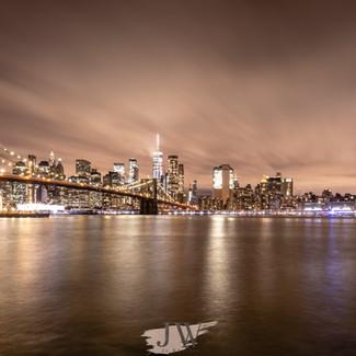 A view of Brooklyn Bridge at night.