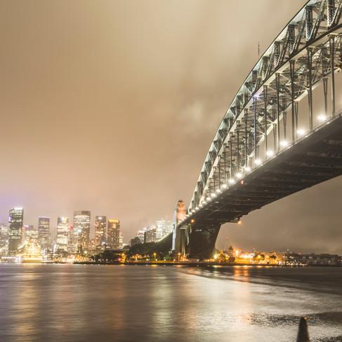 Sydney Harbour Bridge and City Scape in low cloud