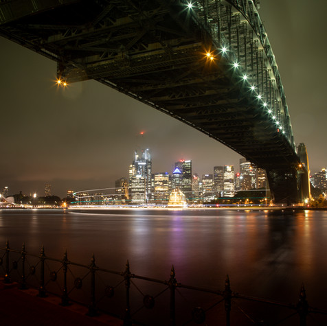 View of Sydney Opera House, bridge and city skyline.