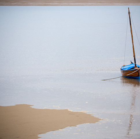 Boat in rising tide at Liverpool Bay