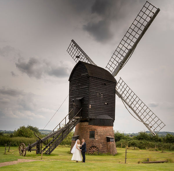 Danzy Green Windmill, Avoncroft Museum with bride and groom standing in front