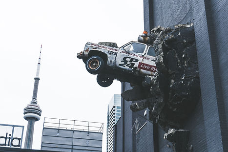 A car bursting out of a building wall