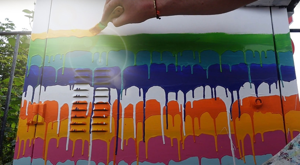 Painting an electrical box for an art festival