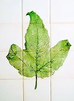 LARGE LEAF DESIGN PAINTED ON TILES