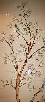 Bird and branch design hand painted on tiles