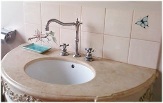 SINK WITH HANDPAINTED TILE SPLASHBACK