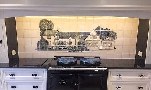 fruit bowl painted on tiles as back splash behind an aga