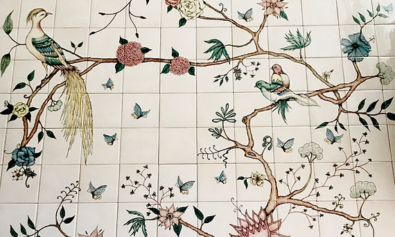 bespoke bird and branch design on tiles.