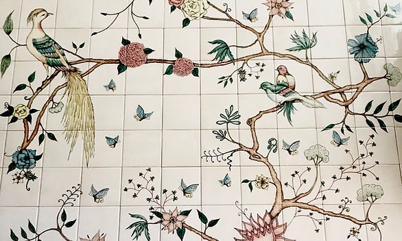 bespoke bird and branch design on tiles.