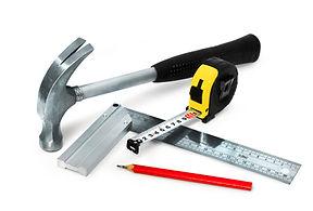 Basic construction tools set on white ba