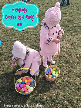 Twin girls with plastic eggs in baskets