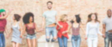 Happy millennials friends jumping outdoo
