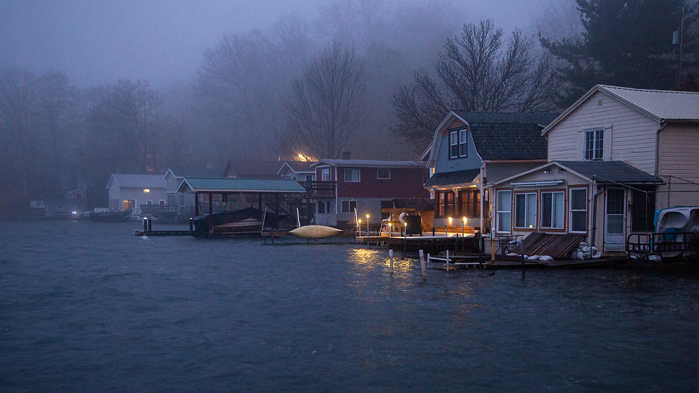 Foggy lakeside cabins