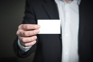 person-holding-white-paper-326569.jpg