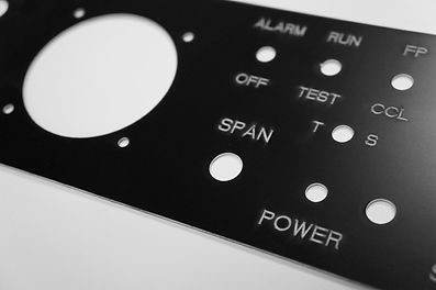 Laser cut and Laser etch of two color layered acrylic sheet to create the face plate of a control panel