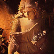 Sculpture Of An Angel With Dark Backgrou