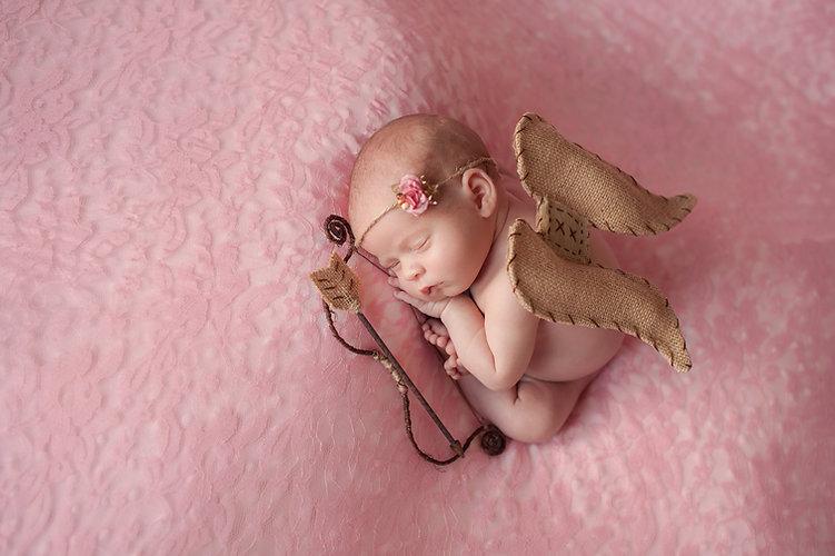 Newborn Baby Girl Wearing Cupid Wings.jp