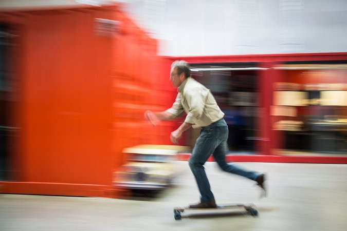 Mr. Park occasionally rides his skateboard around the warehouse.
