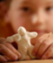 young boy with plasticine.JPG